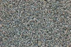Crushed stone. Gray rubble, scattered on the ground Royalty Free Stock Photo