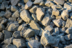 Crushed stone or angular rock. Is a form of construction aggregate, typically produced by mining a suitable rock deposit and breaking the removed rock down to Stock Photography