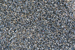 Crushed stone. Background from small crushed stone Stock Image