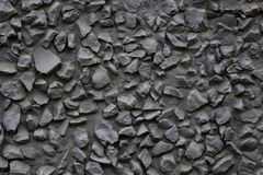 Crushed stone in concrete. As wall decoration Royalty Free Stock Photo
