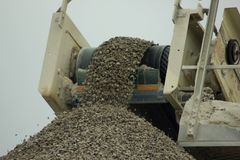 Crushed stone strew in rubble mound. Rubble stones strew from the conveyor belt Stock Photography