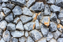 Crushed stone wall background Stock Images