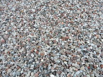 Crushed stones patter. Different shape and colors natural stones background royalty free stock photography