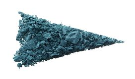Crushed texture of navy blue eye shadow or powder. Crushed texture of navy blue eye shadow isolated on white background. Macro texture of broken dark blue powder stock photo