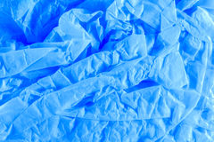 Crushed tissue. A close up of blue crushed tissue paper stock image