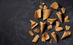 Crushed waffle ice cream cones on a black background. Top view with copy space scoops summer dessert delicious sweet cold flavor tasty fresh sundae frozen royalty free stock images