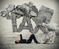 Crushed by the weight of taxes Royalty Free Stock Photography