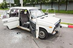 Crushed white VAZ-2106 car, closeup photo Stock Photos