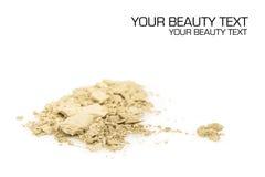 Crushed yellow eyeshadows on white background Stock Photo