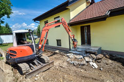 A crusher is demolishing a house Royalty Free Stock Images