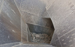 Crusher. Detail shot of the feed hopper of a stone crusher Royalty Free Stock Photo
