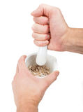 Crushing brown sugar cubes with marble mortar Stock Image