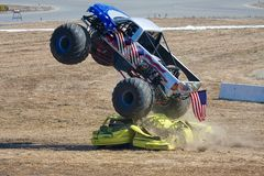 Crushing Cars. Monster truck crushing some cars stock image