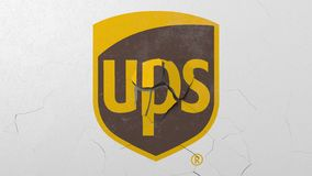 Crushing concrete wall with logo of UPS. Crisis conceptual editorial 3D rendering. Breaking wall with painted logo. Conceptual 3D stock illustration