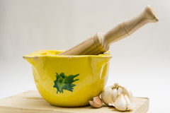 Crushing garlic cloves Stock Photography