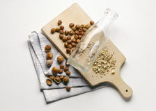 Crushing hazelnuts with a glass bottle. Food, gastronomy, cooking,cookery Royalty Free Stock Photos