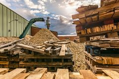 Crushing machine of wood and logs to process waste and transform into pellets stock photo