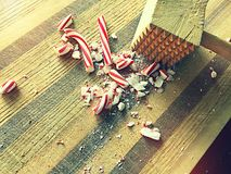 Crushing peppermint candies. Using mallet to crush candy canes Royalty Free Stock Photos