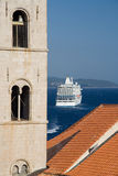 Crusing Dubrovnik. A cruise ship leaving Dubrovnik Harbor royalty free stock photo