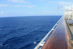 Crusing at sea. Crossing the Caribbean ocean on a cruise ship. view over the railing of the deck, sea and sky Royalty Free Stock Photography