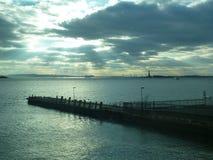Cruspuscular rays on a New York pier Royalty Free Stock Photos