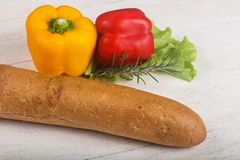Crust baguette. With vegetables over wooden backgroind Stock Photography