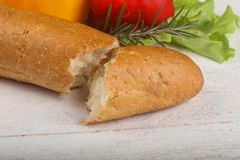 Crust baguette. With vegetables over wooden backgroind Royalty Free Stock Photos