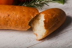 Crust baguette. With vegetables over wooden backgroind Stock Photos