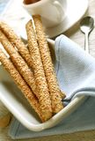 Crust sticks with sesame on plate. Crust sticks with sesame and napkin on plate Royalty Free Stock Photos