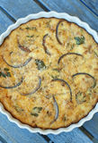 Crustless Quiche. Quiche with fresh sauteed onions garlic and herbs Royalty Free Stock Images
