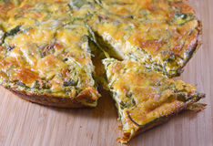 Crustless spinach quiche on a wooden board. Close-up on a crustless spinach quiche on a wooden board Royalty Free Stock Photo
