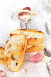 Crusty baguette with garlic. Royalty Free Stock Images