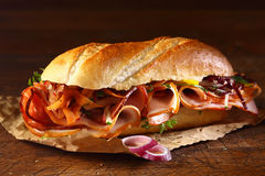 Crusty baguette with ham and onion Royalty Free Stock Photography