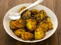 Crusty baked potatoes Stock Photo