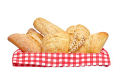 Crusty bread buns into the basket Stock Images