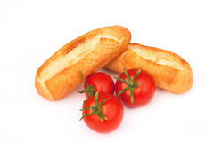 Crusty Bread rolls and tomatoes Royalty Free Stock Images