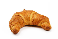 Crusty brown croissant. On white background royalty free stock photo