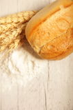 Crusty fresh roll with wheat and flour Royalty Free Stock Photo