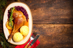 Crusty goose leg with braised red cabbage and dumplings Royalty Free Stock Photo