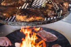 Crusty pork roast on a bbq grill royalty free stock photo
