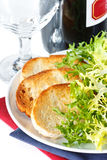 Crusty toastes and salad. Stock Image