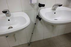 Crutch. In the public bath Royalty Free Stock Image