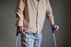 Crutches. Depression, man with crutches on dark background Royalty Free Stock Image