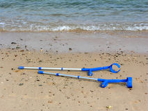 Crutches on beach Stock Photo