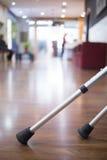 Crutches on floor in hospital clinic waiting room Stock Photos