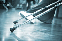 Crutches on floor in hospital clinic waiting room Royalty Free Stock Photos