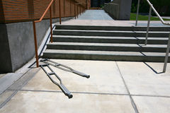 Crutches in front of a stairway Stock Photos
