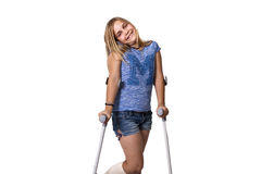 Crutches. Little girl with crutches isolated on white background Royalty Free Stock Photography