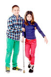 Crutches. Little girl with crutches isolated in white with friend stock images