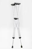 Crutches. On a white background Stock Photos